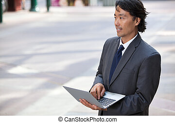 Business Man with Laptop Outdoors - Handsome businessman...