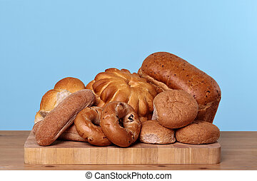 Assortment of bread on a bread board