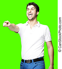 man pointing and joking - portrait of young man pointing and...