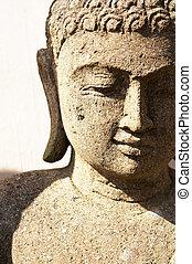 Stone Buddha Statue - A stone Buddha Statue under bright...