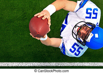 Overhead American football player catching the ball -...