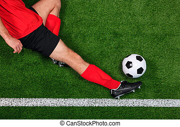 Overhead football player sliding - Overhead photo of a...