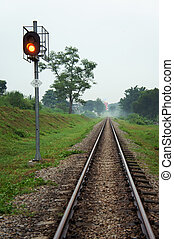 Railway track with Trafficlight towards city