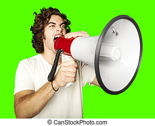 man with megaphone - portrait of young man shouting with...