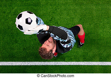 Overhead shot of a goalkeeper saving the ball in the air. -...