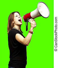 young with megaphone - portrait of young woman shouting with...