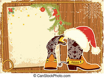 Billboard frame with cowboy boots and Santas red hat on wood...