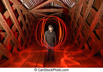 Sinister guy - sinister guy surrounded by red light in a...