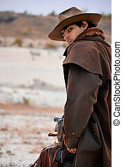 cowboy - handsome cowboy in specific clothing with weapon...