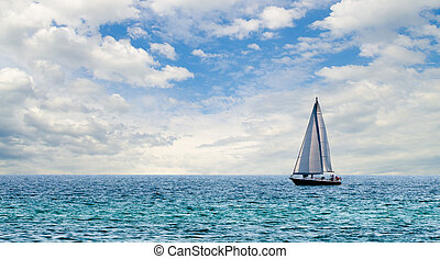 Sailboat on light blue water off Florida Gulf Coast