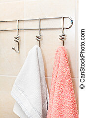 Two terry towels hanging on a hook