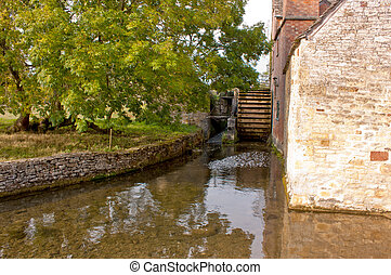 Mill Wheel in Lower Slaughter - A view of an old mill wheel...