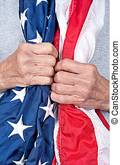 Elderly woman holding American flag - An elderly partiotic...