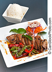 Thai Chile Basil Duck Dish with Rice - A fresh dish of Thai...