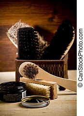 Shoe polishing tools - photo of various brushes on wooden...