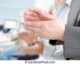 Closeup of hands applauding - Business team applauding in...
