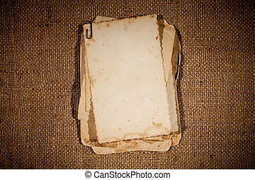 old photos bunch over burlap texture as a template for your...