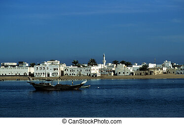 old harbor city Sur in Oman seen from the sea