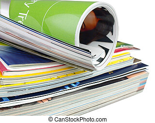 Pile of magazines - Many colourful magazines on the white...