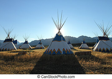 Teepees - Colorful teepees set up in a circle with the Rocky...