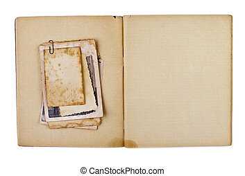 blank old opened diary or copybook with photos bunch isolated on white