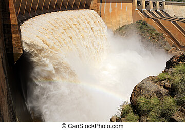 Dam wall with open sluice gates - Strong flowing water...