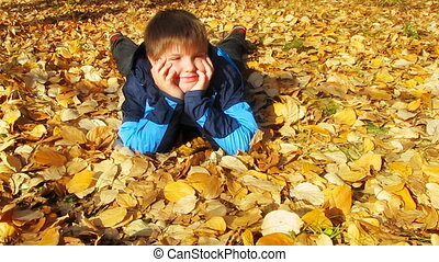 young boy in autumn park
