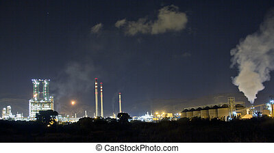 Petrochemical refinery at night with full moon light