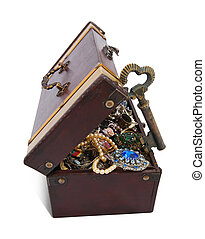 Gold key in treasure chest - wooden treasure chest with...
