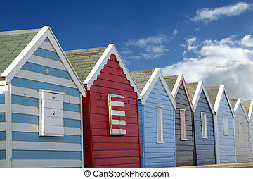Beach huts and blue sky - Line of brightly-coloured beach...
