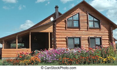 Cottage. - Country log house in the sunny summer day.
