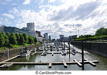 Dusseldorf, Germany - River port and Skyscrapers in...