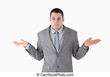 Businessman ignoring the answer against a white background