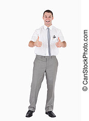 Portrait of an office worker with the thumbs up against a...