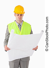 Portrait of a builder looking at a plan