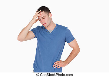 Tired young man against a white background
