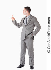 Portrait of a businessman pointing at something
