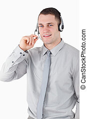 Portrait of a smiling assistant using a headset