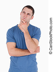 Portrait of a pensive man against a white background