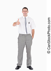 Portrait of an office worker with the thumb up against a...