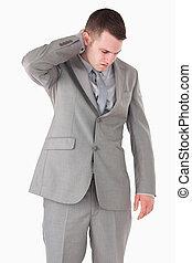 Portrait of a businessman having a neck pain