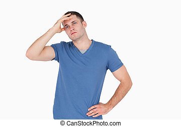 Depressed young man against a white background