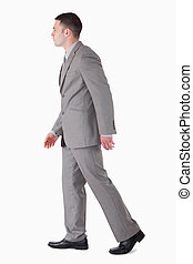 Portrait of a businessman walking against a white background