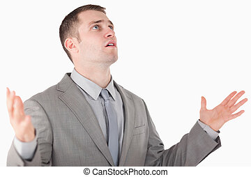 Worried entrepreneur praying against a white background