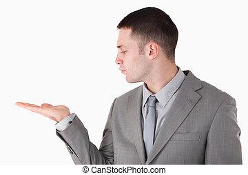 Businessman holding something