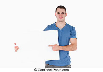 Man pointing at a blank panel