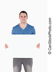 Portrait of a man holding a blank panel