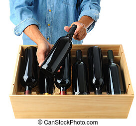 Winemaker with case of wine