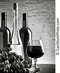 Black and white HDR still-life with wine bottles and grape