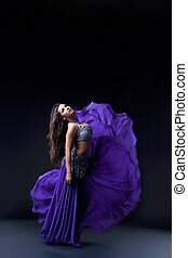 arabia dancer posing with flying fabric